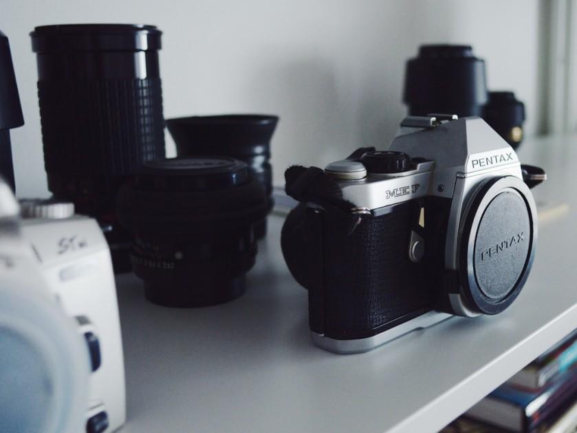 Vintage SLR cameras in my office by Reghan Skerry