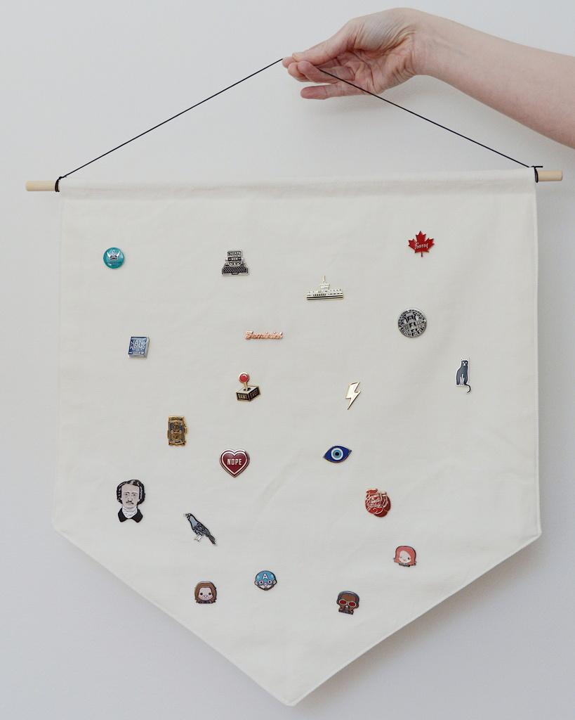 Wall hanging to display enamel pins, by Reghan Skerry.