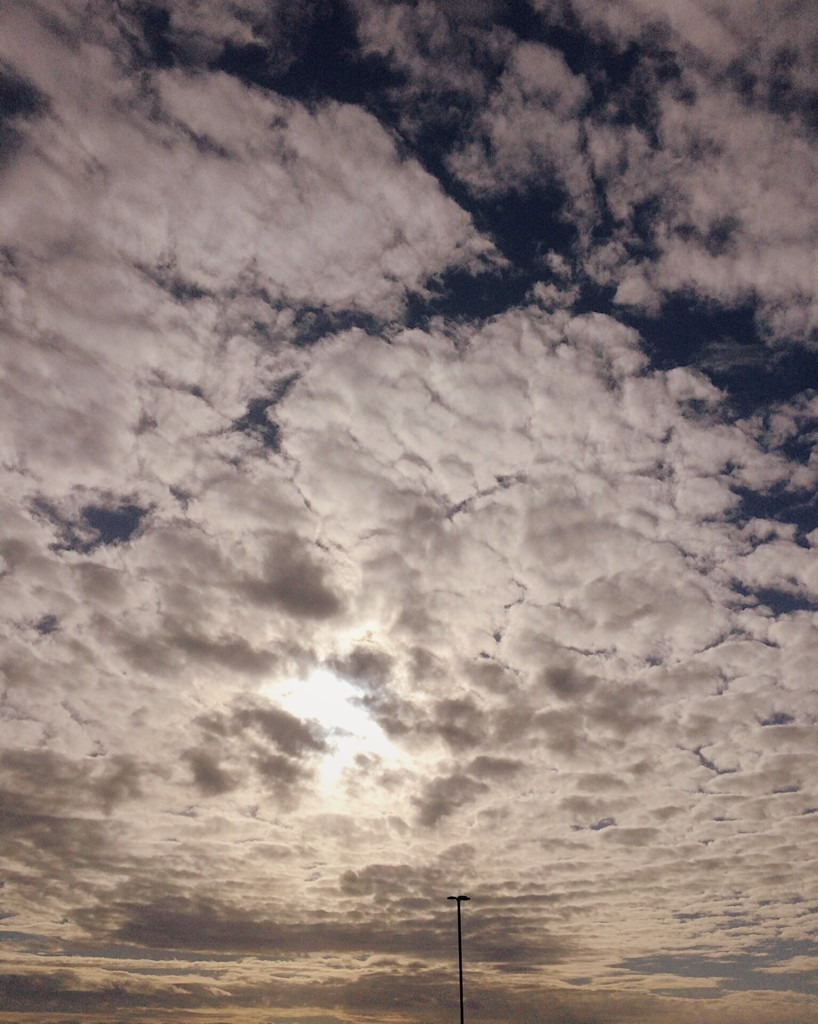 Scattered clouds photographed by Reghan Skerry
