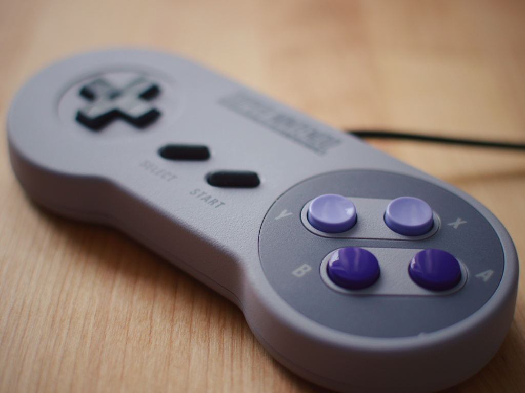 Close up of a Super Nintendo controller by Reghan Skerry