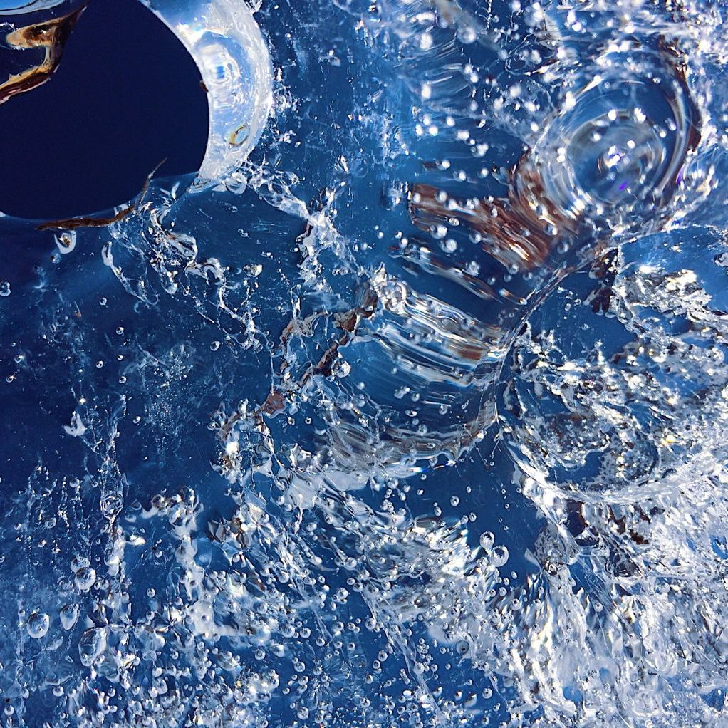 Bubbles in ice, with a blue background, photographed by Reghan Skerry