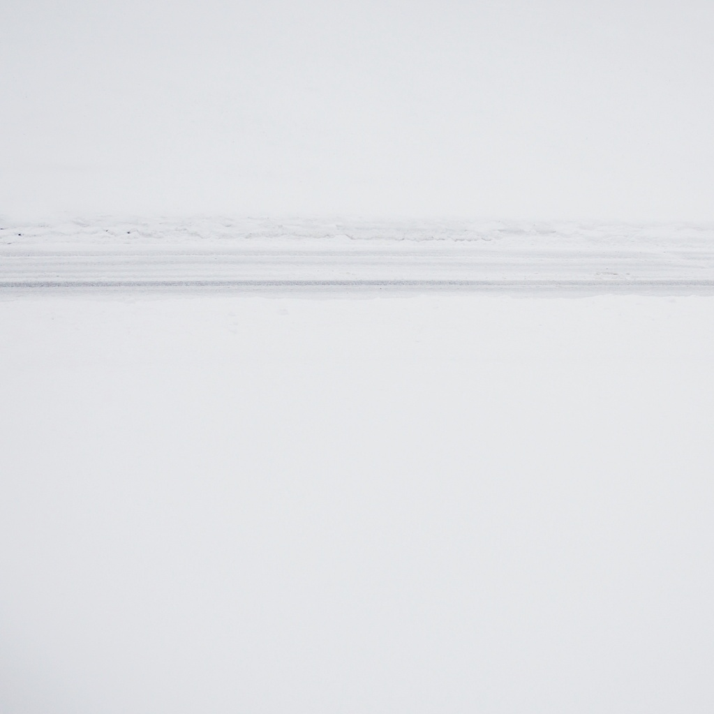 Tire tracks in the snow, photographed by Reghan Skerry