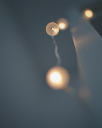 Close up photo of illuminated string lights. Photo by Reghan Skerry.
