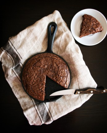 Brownies baked in a cast-iron skillet, with one wedge removed. Photo by Reghan Skerry.
