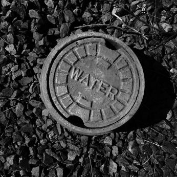 Black and white image of a municipal water access. Photo by Reghan Skerry.