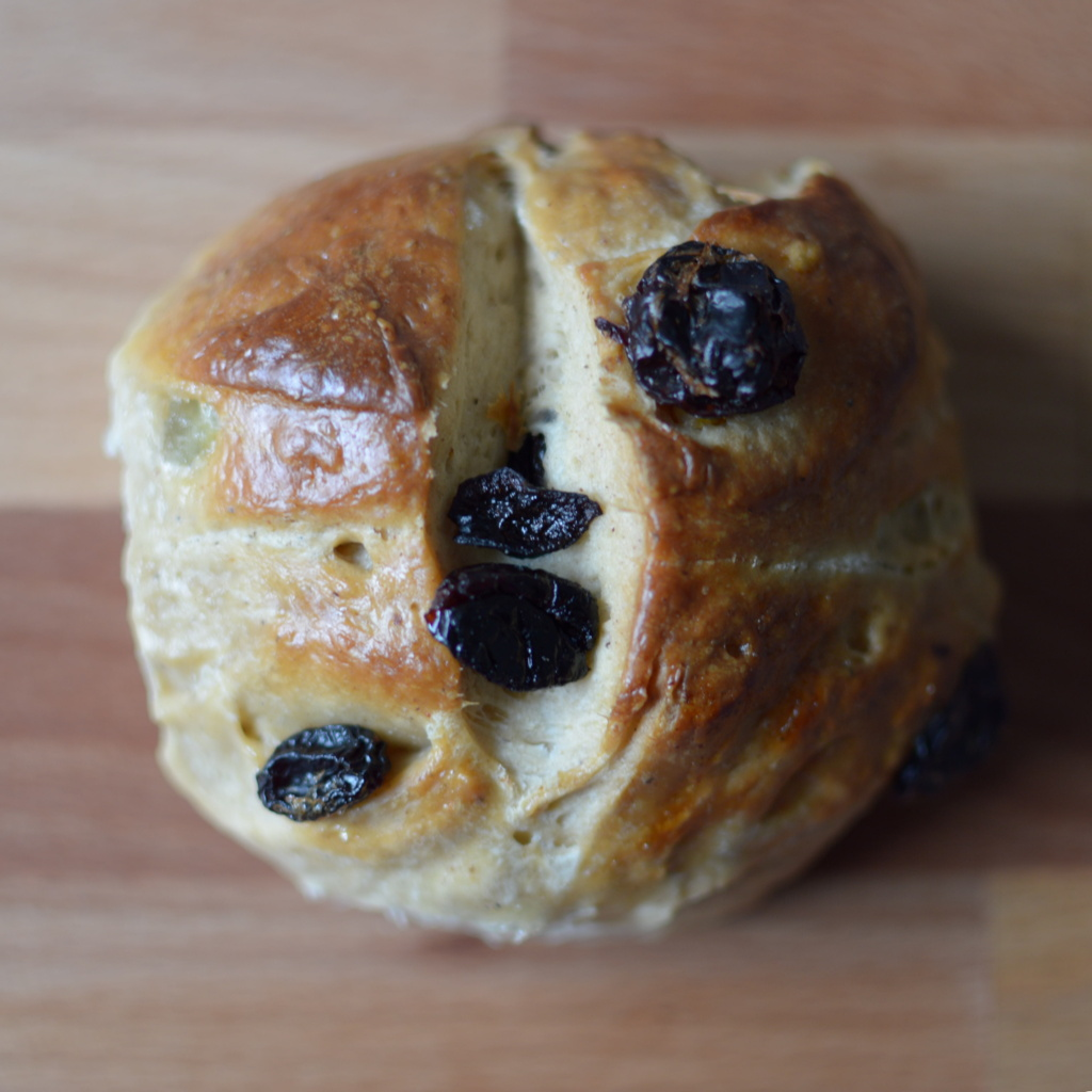 Top view of a homemade hot cross bun. Photo by Reghan Skerry.
