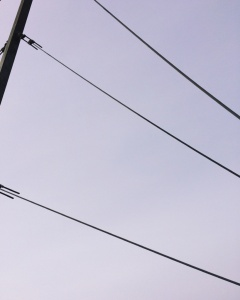 Wires against a cloudy sky. Photo by Reghan Skerry.