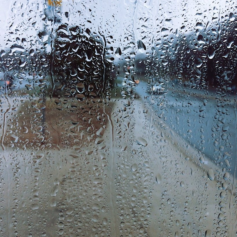 Street scene through rain-spattered glass. Photo by Reghan Skerry.