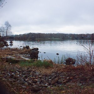 Photo of Lake Banook, with rocks in the foreground. Photo by Reghan Skerry.