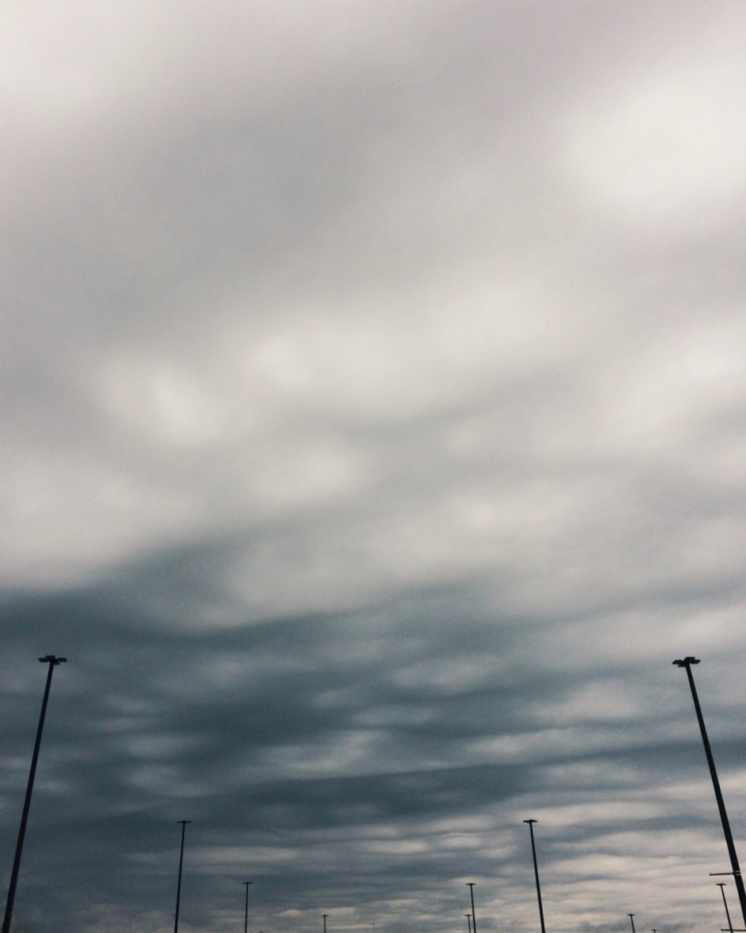 Ominous clouds and lamp posts. Photo by Reghan Skerry.