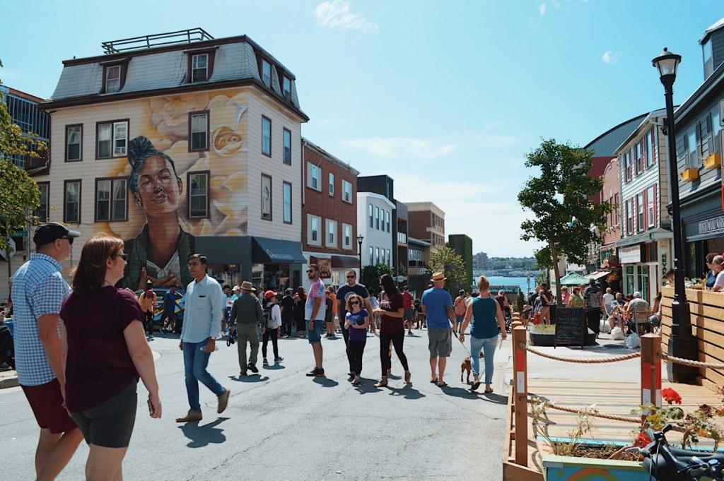 People walking on Portland Street. Photo by Reghan Skerry.