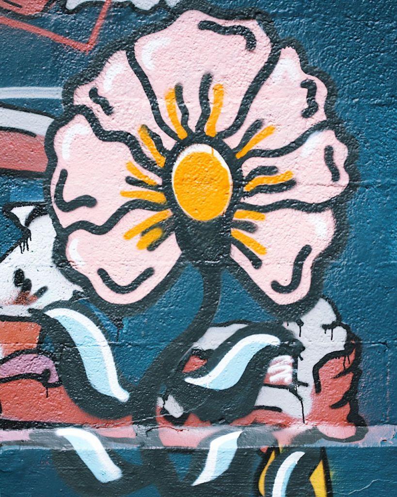 Street art of a flower. Photo by Reghan Skerry.