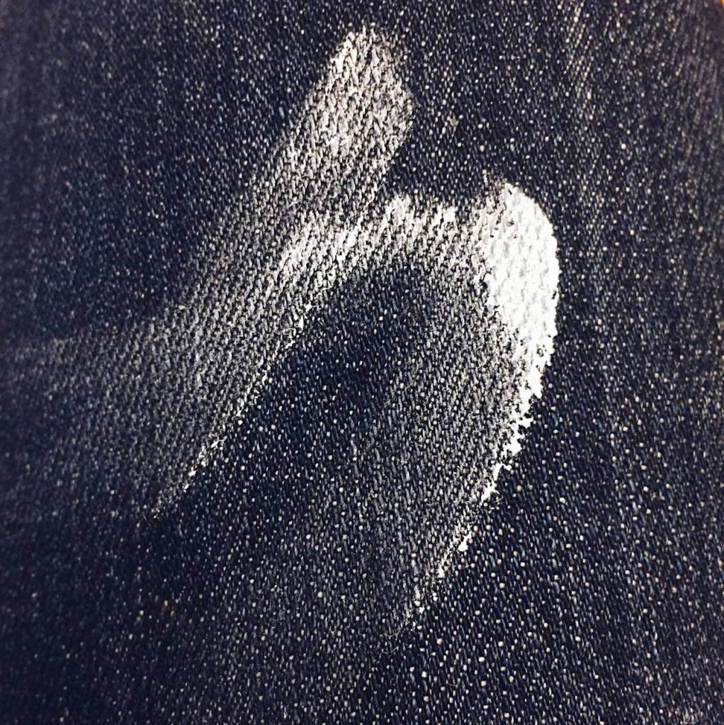 White paint on denim. Photo by Reghan Skerry.