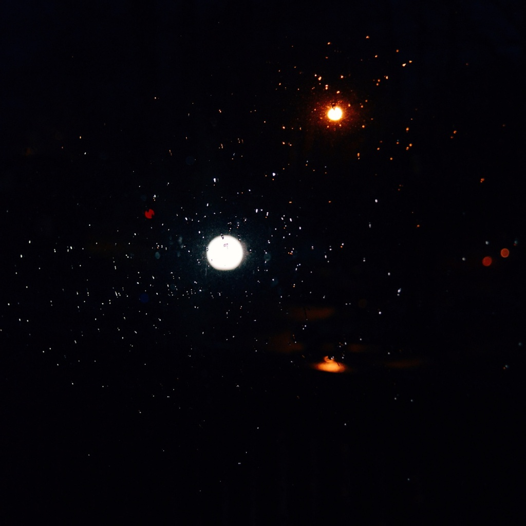 Streetlights reflected in raindrops. Photo by Reghan Skerry.