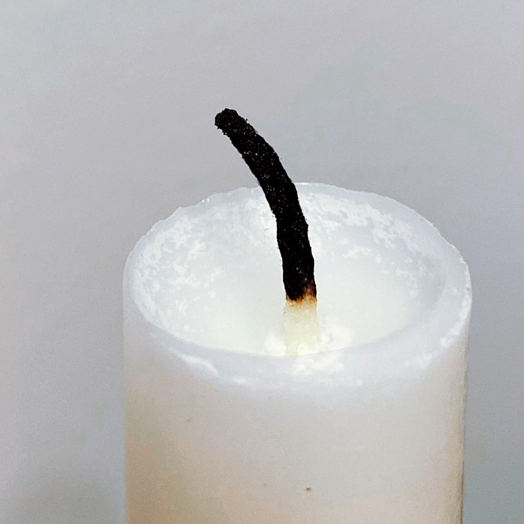 Close up of an unlit candle. Photo by Reghan Skerry.