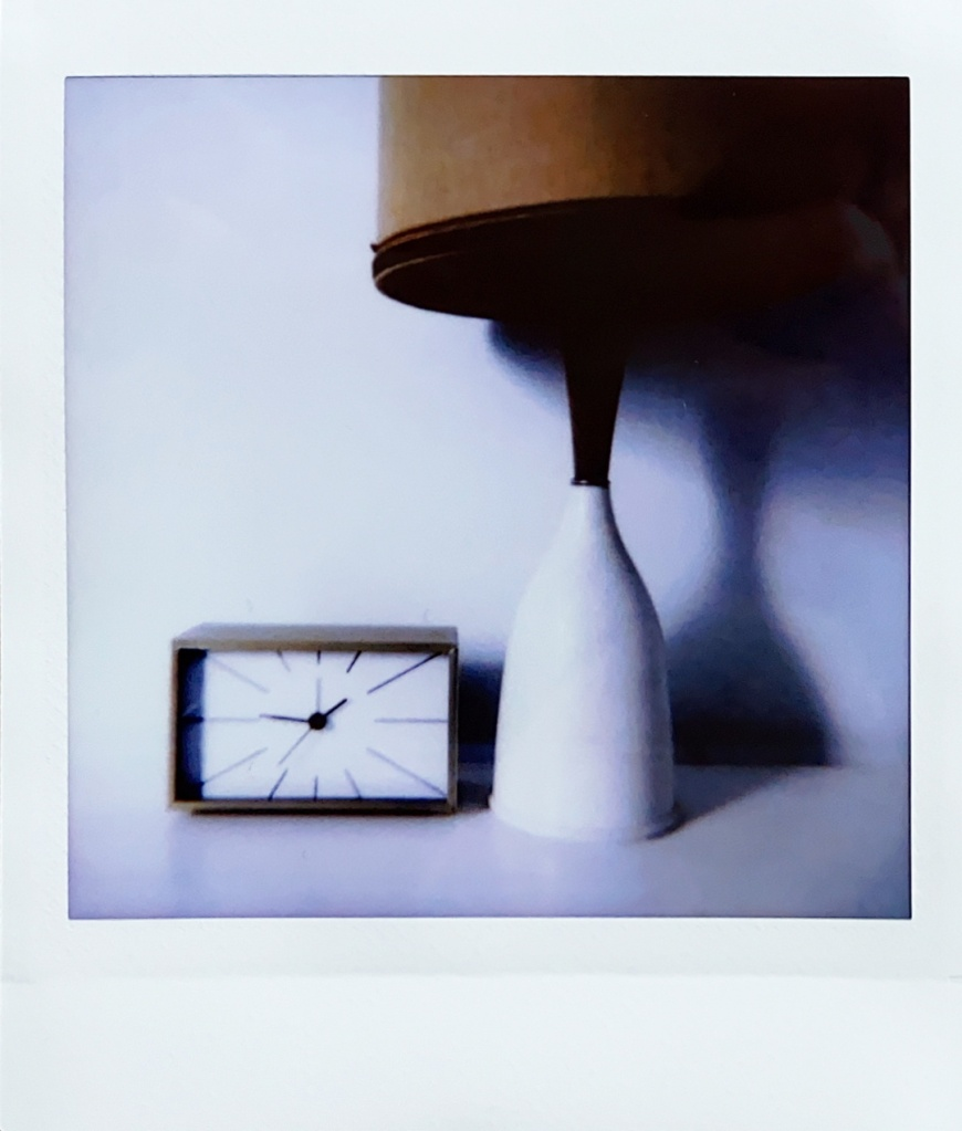 Instax photo of a lamp and alarm clock. Photo by Reghan Skerry.