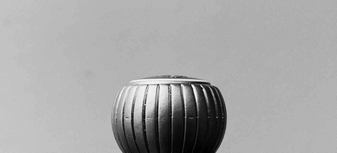 Black and white photo of a round sculptural object. Photo by Reghan Skerry.